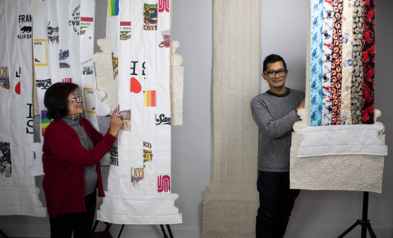 am image of the artist and his mom with the quilts they made for the exhibition Fiber Structure
