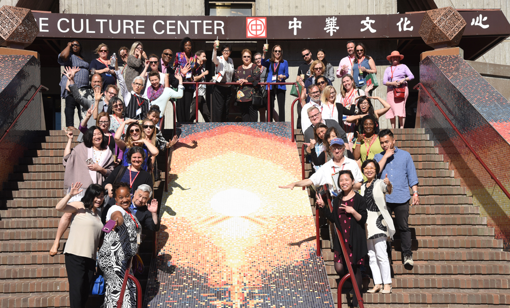 A group of people standing by a mosaic staircase in front of the Chinese Culture Center