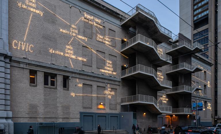Neon words on the brick facade of the Bill Graham Auditorium